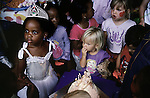 Lebone Dube, age 4, with her friends at her birthday party on February 29, 2004 in Cedar Lake, an up-market gated community in Johannesburg, South Africa. Her parents belong to the new black elite in SA. Lebone attends an exclusive pre-school with mostly white children, and she invited them for her birthday party. Well educated and connected, some have risen from the poverty in the townships to a new lifestyle, since the fall of Apartheid and the start of democracy in the country in 1994. (Photo by: Per-Anders Pettersson)