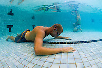 Mick  Fanning and Leo Fioravanti  training in an indoor pool with Nam  Baldwin doing breathing exercises and simulating wipeouts at Coolangatta, Queensland, Australia on Wednesday February 19, 2014