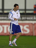 Lionel Messi of Argentina laughs during the training session