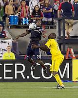 New England Revolution midfielder Shalrie Joseph (21) chest trap as Columbus Crew defender Andy Iro (6) defends. The New England Revolution tied Columbus Crew, 2-2, at Gillette Stadium on September 25, 2010.