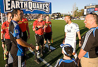 Referee Paul Ward prepares to toss a coin during coin toss ceremony before the kick off at Buck Shaw Stadium in Santa Clara, California on July 20th, 2011.  Earthquakes and WhiteCaps are tied 1-1 at halftime.
