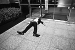A drunk salaryman is passed out on the street in Tokyo, Japan. May 7, 2010.