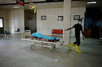 Tripoli, Libya, August 26, 2011.About 100 bodies are recovered in Abu Salim Hospital before being transfered to a functionning morgue in another Tripoli hospital. Details of what happened are unclear, but it seems most were wounded Khaddafi soldiers who were later executed on their hospital beds in what constitutes a massive war crime..