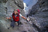 Adlerweg, Tirol, Austria, August 2005. Scrambling over scree on the trail to Dremelscharte (pass).The Adlerweg (eagles trail) is the new long distance hiking trail in Austria. The Adlerweg connects existing paths throughout Tirol, in the shape of an eagle, Tirol's provincial symbol. Photo by Frits Meyst/Adventure4ever.com