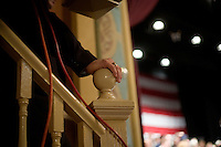 Members of the Romney security team stand watch at the edge of events at a Mitt Romney town hall meeting and rally at the Rochester Opera House in Rochester, New Hampshire, on Jan. 8, 2012. Romney is seeking the 2012 Republican presidential nomination.