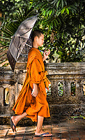 This young monk looks deep in concentration as he walks beside the Mekong. (Photo by Matt Considine - Images of Asia Collection)