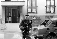 Bosnian government soldiers engage Bosnian Serbs in house to house fighting in Sarajevo on June 24, 1992. The Dobrinja neighbourhood was built to house athletes for the 1984 winter olympic games.