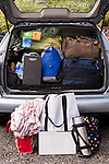 Family on vacation with their automobile packed with suitcases, bags, blankets and more Westport Washington State