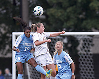 University of North Carolina midfielder Crystal Dunn (19) and Boston College defender McKenzie Meehan (22) battle for head ball. University of North Carolina midfielder Katie Bowen (15).  University of North Carolina (blue) defeated Boston College (white), 1-0, at Newton Campus Field, on October 13, 2013.