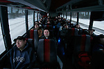 Workers sleep in the bus that transports them one hour north of Ft. McMurray, Alberta, to the Albian Sands-Muskeg River Mine,  on Tuesday, March 14, 2006. .John Ulan
