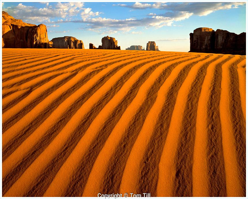 Sand dunes and monoliths, Monument Valley Tribal Park, Arizona