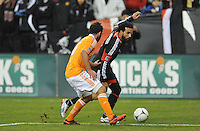 D.C. United midfielder Dwayne De Rosario (7) goes against Houston Dynamo midfielder Adam Moffat (16) D.C. United tied The Houston Dynamo 1-1 but lost in the overall score 4-2 in the second leg of the Eastern Conference Championship at RFK Stadium, Sunday November 18, 2012.
