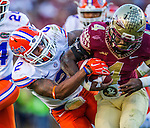Personal Work<br /> <br /> Florida defensive back Jabari Gorman tries to strip the ball from Florida State running back Dalvin Cook in an NCAA football game in Tallahassee, November 29, 2014.