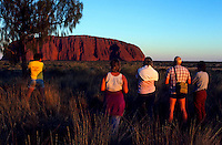 Tourist watching the sunset at Ayers Rock or also called Uluru, in Central Austarlia