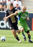 Alejandro Moreno #15 of the Philadelphia Union grabs onto Freddie Ljungberg #10 of the Seattle Sounders FC during the first MLS match at PPL stadium in Chester, Pa. on June 27 2010. Union won 3-2.