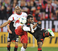 Brandon McDonal (4) of D.C. United goes against Jamison Olave of The New York Red Bulls (4) The New York Red Bulls defeated D.C. United  2-0, at RFK Stadium, Saturday April 13, 2013.
