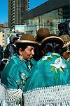 Bolivian cholitas dressed in bowler hats and mantas or shawls, the traditional indigenous Aymaran dress, celebrating Bolivian Independence Day in La Paz, Bolivia.
