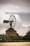 Unique windmill with Halladay turbine in village Ruprechtov, near Brno, Czech Republic. Cyril Wágner the owner and builder installed in 1882 thru 1884 a Halladay turbine, named after its inventor and design engeneer, American farmer Daniel Halladay. The runner consists of a chain of operable vanes controlled by rods, enabling them to be tilted as required automatically according to the wind. Duble tail vane maintained the wheel at the right course. Using this invention, the mill could double its output in corn processing...The turbine with a diameter of 10 meters, weighing approximatelly 2 tons revolves at about 16 meters above the ground.