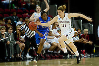 FRESNO, CA--Toni Kokenis forces a turnover en route to a 81-69 win over Duke at the Save Mart Center for the West Regionals Championship of the 2012 NCAA Championships. The Cardinal advances to the Final Four in Denver, facing Baylor in the semifinals.