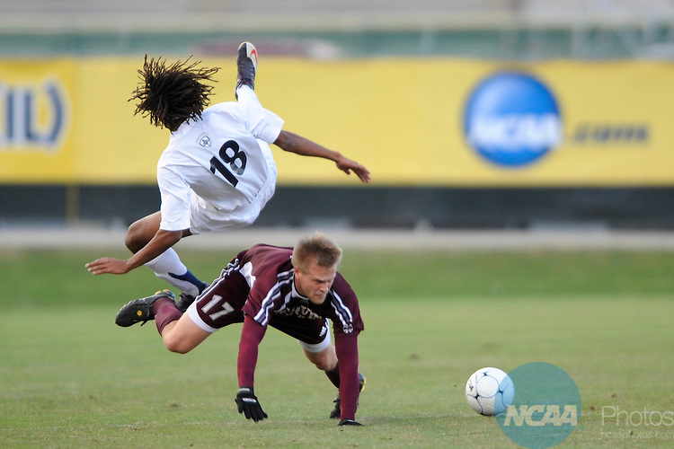 05 DEC 2009:  Jevon Gondwe (18) of Messiah College collides with Kyle Billen (17) of Calvin College during the Division III Men's Soccer Championship held at Blossom Soccer Stadium hosted by Trinity University in San Antonio, TX. Messiah defeated Calvin 2-0 for the national title.  Brett Wilhelm/NCAA Photos