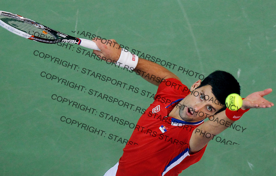 BELGRADE, SERBIA - NOVEMBER 17: Novak Djokovic of Serbia serves the ball during the men's singles match between Novak Djokovic of Serbia and Tomas Berdych of Czech Republic on day three of the Davis Cup World Group Final between Serbia and Czech Republic at Kombank Arena on November 17, 2013 in Belgrade, Serbia. (Photo by Srdjan Stevanovic/Getty Images)