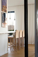 A tidy breakfast bar in the kitchen/dining room offers an alternative area for a quick meal