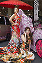 January 13, 2012, Chiba, Japan - Models pose next to a custom car during the 2012 Tokyo Auto Salon at Makuhari Messe. The car show runs from January 13-15. (Photo by Christopher Jue/AFLO)