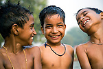 Three friends, just out of a frolicking time in a pond in New Delhi, unable to contain their excitement. Photograph &copy; Santosh Verma