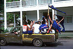 High school boys travelling in truck to base ball game, Pago Pago,American Samoa, U.S.A - 1980