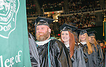 Socioliogy students Ryan Hopper (Left) and Jacklyn Hockenberry (Center) receive their masters degrees at graduate commencement. Photo by Ben Siegel