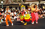 Orlando, Florida - Circa 1986. Minnie Mouse dances in Disney World street festival. Disney World is a world-renowned entertainment complex that opened October 1, 1971 in Lake Buena Vista, FL. Now known as the Walt Disney World Resort, the property covers 25,000 acres and has an annual attendance of 52.5million people.