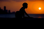 Silhouette of cuban boy near on Coast