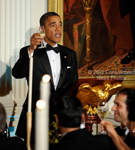 United States President Barack Obama toasts South Korean President Lee Myung-bak during a State Dinner in the East Room of the White House in Washington, DC on Thursday, October 13, 2011. The State Visit comes only a day after congress passed a free trade agreement with South Korea.   .Credit: Roger L. Wollenberg / Pool via CNP