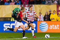 Alex Morgan (13) of the United States (USA) is marked by Saskia Bartusiak (3) of Germany (GER). The United States (USA) and Germany (GER) played to a 2-2 tie during an international friendly at Rentschler Field in East Hartford, CT, on October 23, 2012.