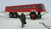 Ivan the Terra Bus, a huge transport vehicle, picks up arriving air passengers at Willy Field near McMurdo Station, Antarctica in January, 2001