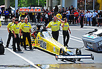 May 6, 2012; Commerce, GA, USA: NHRA crew members for top fuel dragster driver Spencer Massey during the Southern Nationals at Atlanta Dragway. Mandatory Credit: Mark J. Rebilas-