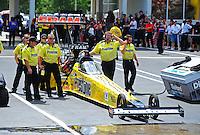 May 6, 2012; Commerce, GA, USA: NHRA crew members for top fuel dragster driver Spencer Massey during the Southern Nationals at Atlanta Dragway. Mandatory Credit: Mark J. Rebilas-
