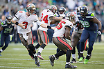 Tampa Bay Buccaneers quarterback Mike Glennon (8) hands off to running back Michael james (25) at CenturyLink Field in Seattle, Washington on  November 3, 2013.  The Seahawks beat the Buccaneers 27-24 in overtime. ©2013. Jim Bryant. All Rights Reserved.