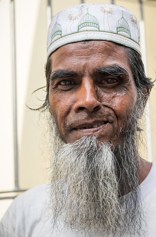 YANGON, MYANMAR - CIRCA DECEMBER 2013: Portrait of a man in the streets of Yangon