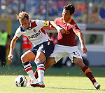 Calcio, Serie A: Roma vs Bologna. Roma, stadio Olimpico, 16 settembre 2012..Bologna forward Alessandro Diamanti is challenged by AS Roma defender Ivan Piris, of Paraguay, right, during the Italian Serie A football match between AS Roma and Bologna at Rome's Olympic stadium, 16 september 2012..UPDATE IMAGES PRESS/Isabella Bonotto