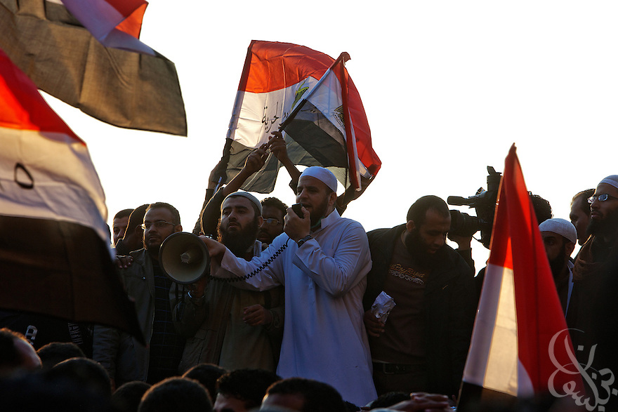 Salafist Egyptian protesters speak against military rule November 22, 2011 in Tahrir square in central Cairo, Egypt. Thousands of protestors demanding the military cede power to a civilian government authority clashed with Egyptian security forces for a fourth straight day in Cairo, with hundreds injured and at least 29 protestors killed so far.  (Photo by Scott Nelson)