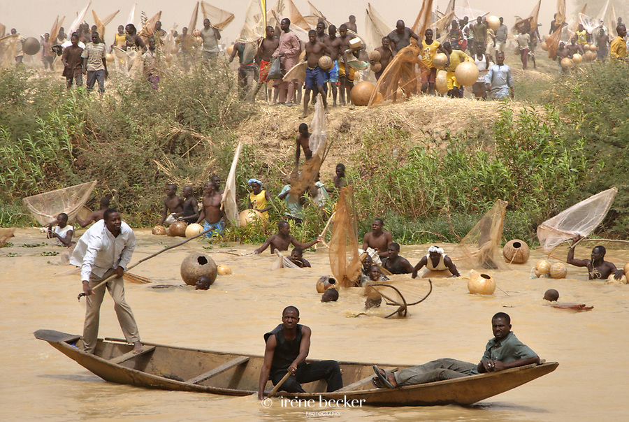 Thousands of fishermen lined up along River Rima, waiting to wade into the Matan Fada river. A scene from the 2009 Argungu Fishing Festival