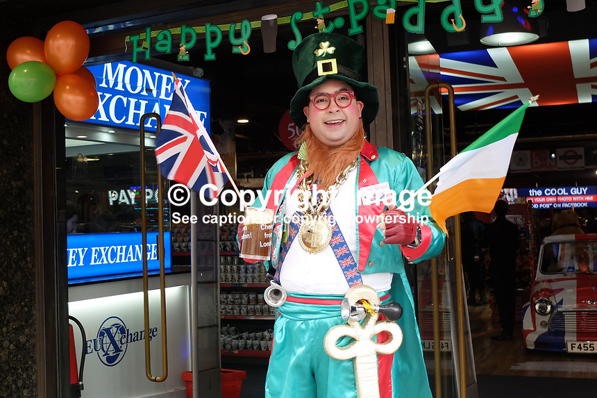More people celebrate St Patrick&rsquo;s Day that were born in Ireland or are of Irish extraction. It&rsquo;s an excuse to celebrate worldwide usually in excess. This guy In Piccadilly, London, uses it to promote his bureau de change wearing an outfit of a type never worn in Ireland. 17th March 2017. 201703173338<br />