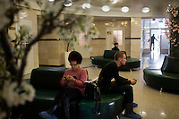 "Patients wait for treatment and diagnosis in the Russian Eye and Plastic Surgery Center in Ufa, Bashkortostan, Russia.  The hospital is run by Ernst Muldashev, a writer and surgeon who claims to have invented a medicine and technique using ""alloplant"" to cure a variety of illnesses, syndromes, and diseases including blindness.  Alloplant is derived from human cadavers.  Muldashev is a widely-read author of books about the origin of man. The books, widely read in Russia as science ficition and read outside of Russia primarily by new age and conspiracy theorists, claim that man is descended from aliens or giants.  Muldashev claims to have found evidence of this on exploration trips in the Himalayas.  Muldashev's medical work is widely regarded as fraudulent by outside doctors.  His cure for blindness has been shown to be a fake."