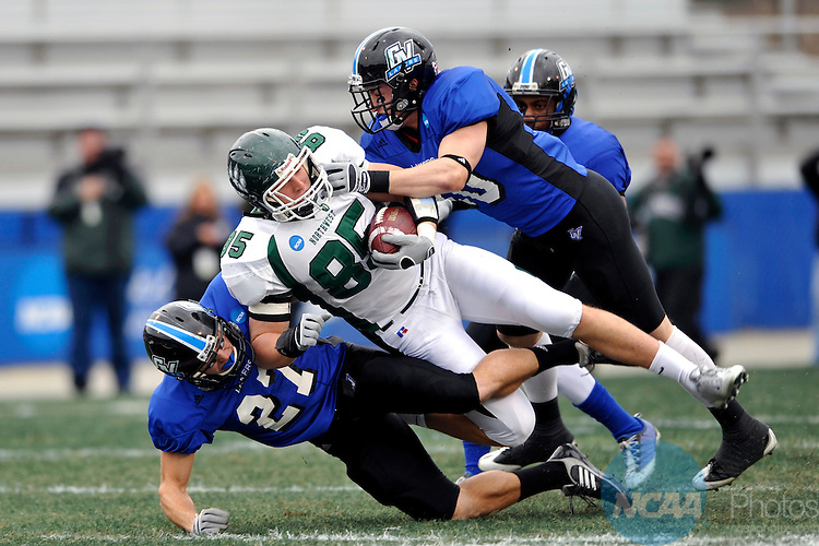 12 DEC 2008: Matt Bakker (27) and Jacob McGuckin (10) of Grand Valley State tackle Kyle Kilgore (85) of Northwest Missouri State during the Division II Men's Football Championship held at Braly Municipal Stadium in Florence, AL. Northwest Missouri State defeated Grand Valley State 30-23 for the national title. Stephen Nowland/NCAA Photos