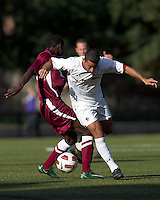 Boston College forward/midfielder Amit Aburmad (7) attempts to dribble through Harvard defense. Boston College defeated Harvard University, 2-0, at Newton Campus Field, October 11, 2011.