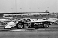 DAYTONA BEACH, FL: The Holbert Racing Porsche 962 103 of Al Unser, Jr., Derek Bell and Al Holbert on the infield road course during the 24 Hours of Daytona on February 3, 1985, at the Daytona International Speedway.
