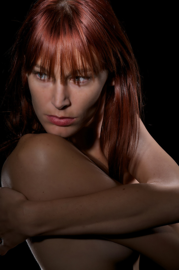 Portrait of a very sensual redhair woman with suggestive looking.