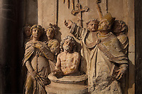 High relief of the baptism of Clovis by St Remi, from the Altarpiece of the 3 baptisms, 1610, attributed to Nicolas Jacques, in the Basilique Saint Remi or Abbey of St Remi, Reims, France. The 11th century, mainly Romanesque, church, contains the relics of St Remi, the Bishop of Reims, who converted Clovis, the King of the Franks, to Christianity in 496 AD. The abbey is a UNESCO World Heritage Site. Picture by Manuel Cohen