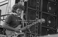 Jerry Garcia with The Grateful Dead at Dillon Stadium in Hartford CT on 31 July 1974. Close in quarter view of Jerry concentrating on his playing. Photo by Michael Thut, Fairfield CT.